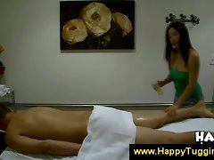 Asian masseuse stroking guy body
