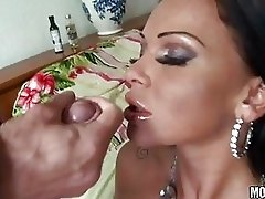 Hot tanned burnette milf with huge melons rides stiff knob on bed