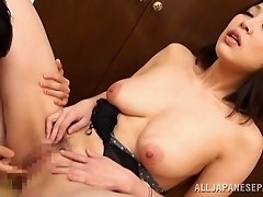 An Asian girl gives him a titjob before giving up that pussy