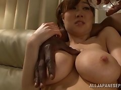 A black guy oils up this hot Asian babes sexy big tits