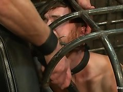 Horny fellas have fun in a gay bondage scene