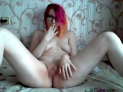 Pale redhead playing with pink pussy