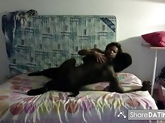 Black milf sucks a big black cock and enjoys riding it