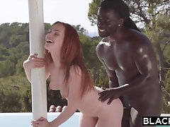 Ginger girl in a crimson bathing suit can't wait to begin railing a hefty, ebony trouser snake