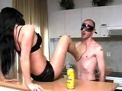 Sultry brunette dominatrix gets her feet licked by her slave