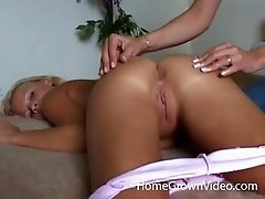 Amateur hottie has her ass oiled up and fingered by a lesbian friend