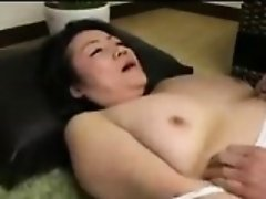 Insatiable Japanese milf seduces a young man to satisfy her