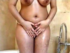 Sexy Pakistani MILF toys her hairy pussy in bath tub