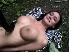 Sensual brunette with big tits gets restrained in the woods
