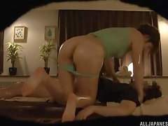 Japanese horny brunette babe massaged and rides dick on the table