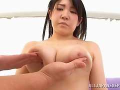 Busty Asian pornstar with long hair giving a stunning titjob