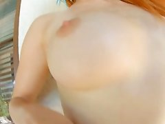 Long haired ginger slut wearing sexy dress shows off her smooth anal hole