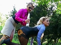 Welcome and watch duo of kinky lesbians stroking their muffs using a vibrator outdoors