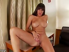 Provocative busty brunette fucks her delicious pussy with sex toys