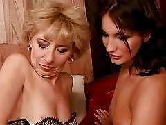 Granny and sexy young brunette making love
