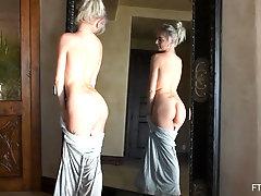 Gorgeous blonde amateur Larissa masturbates in front of a mirror