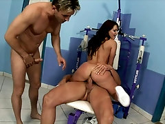 Fit girl double penetrated on a workout machine