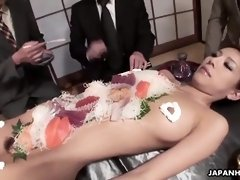 Asian chick is being a food plate for some guys
