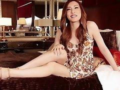 Skimpy satin bra and panty set on a beautiful Japanese tranny