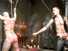 Tattooed gay dude got tied up and punished with a big whip