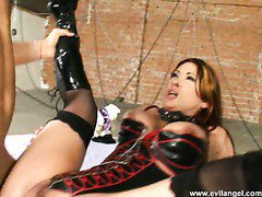 Busty harlot in corset gets her pussy rammed hard by two studs