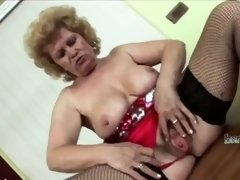 Granny with huge boobs pleasing young cock