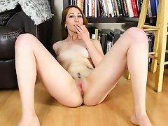 Naughty babe masturbates in the library solo