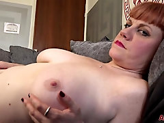 Velvetina Fox is frolicking with her enormous knockers and wetting raw vagina, on the bed