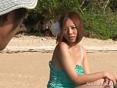 She gives the blowjob of his life in the sand