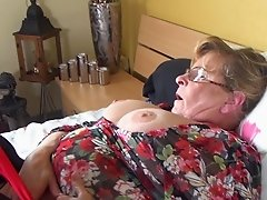 After playing with her toy this mature BBW spreads her pussy open