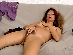 playful mature girl shows off her cute hairy pussy