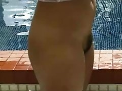 Saggy boobs Asian girl models solo outdoors in the pool