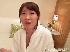 Japanese milf Mai Mizuki lets a man toy her throbbing cunt
