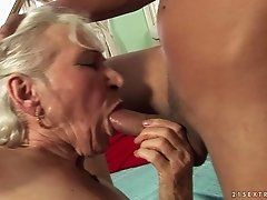 Adorable granny in sexy panties giving a steamy blowjob before moaning as she gets drilled hardcore