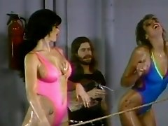Curvy dame displaying her ass while in cat fight in retro shoot