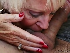 Big breasted blond granny with red nails sucks massive cock of yougn stud with passion
