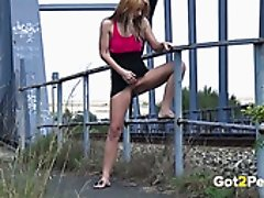 Leggy fair haired hottie pisses a lot near metal bridge