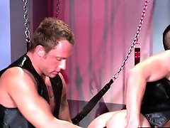 Bdsm bottom leans into ass fisting