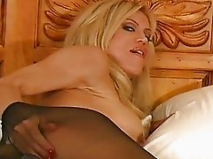 Chick in dark pantyhose drills her twat with a toy