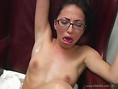 Hot chick in glasses gives footjob after teasing session