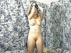 Retro slut gets nude in solo masturbation scene and shows off her sexy ass and natural tits