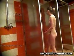 Skinny random girl caught naked on spy cam in the shower