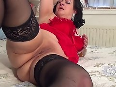 Seductive mature fatty pounds her wet pussy with a sex toy