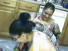 BBW lesbian girls gets messy in chocolate syrup in the kitchen