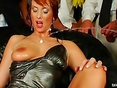 Lovely redhead has her face coated in cum at an epic gang bang shoot
