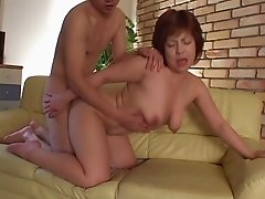 Mature Asian girl mounts up on her man and rides away