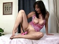 Horn-mad buxom brunette Renie uses pink dildo for drilling her wet slit