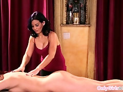 Busty lesbian duo eats pussy on massage table