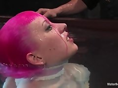 Pink-haired bitch gets restrained and dipped underwater