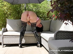 Brunette MILF in leather boots Lara blows and rides cock outdoors
